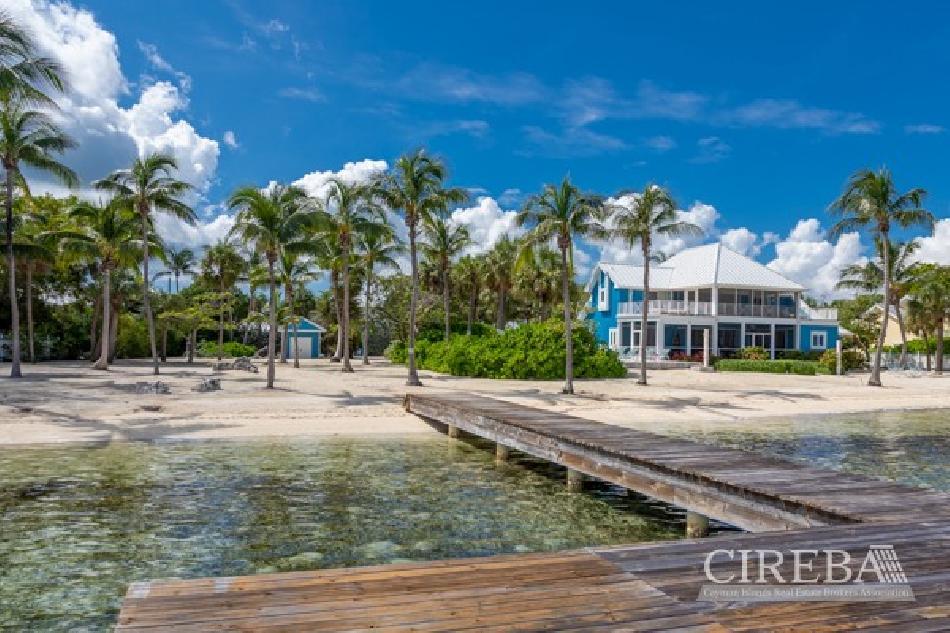 Wastin' away, cayman kai beachfront