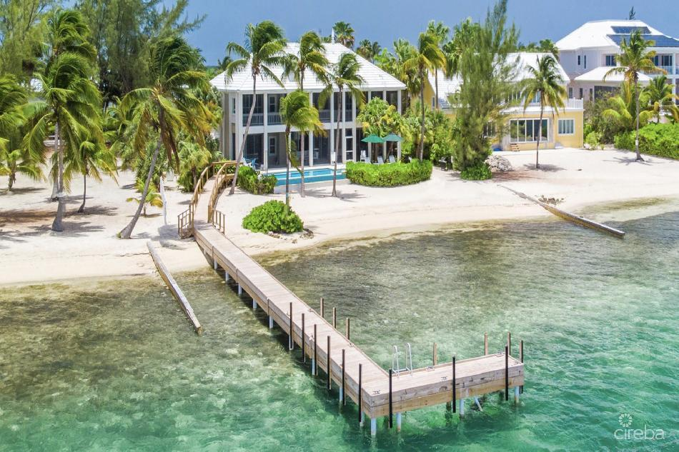 A-bit-a kai beach front residence w/guest house, boat garage and dock!