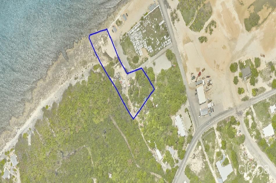Oceanfront cayman brac land and house.