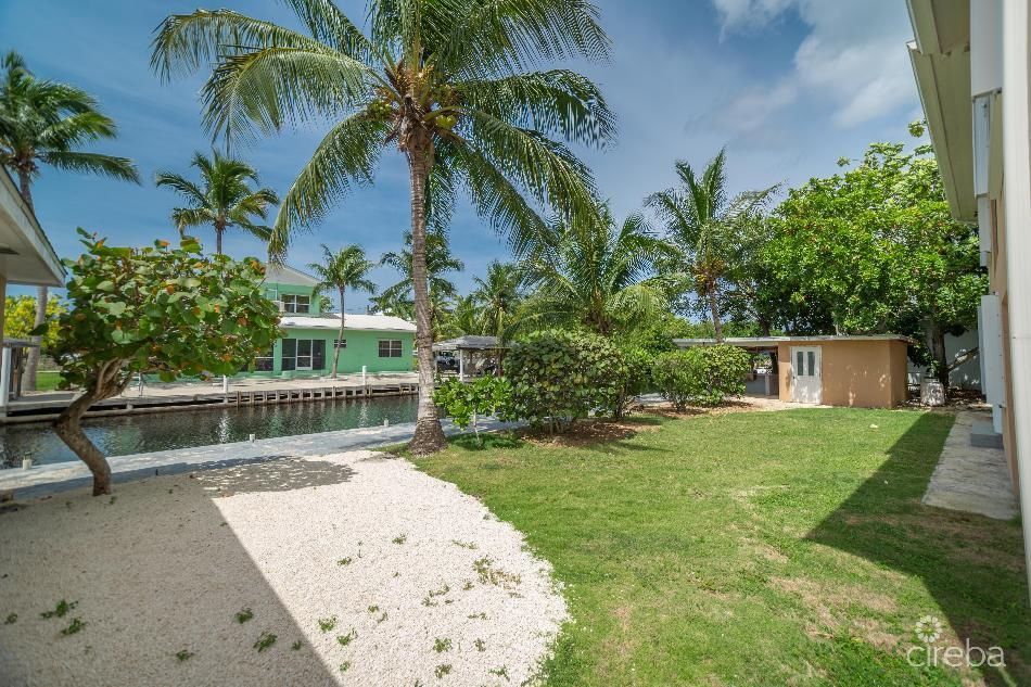 Canal front house with 100ft dock & income producing apartment